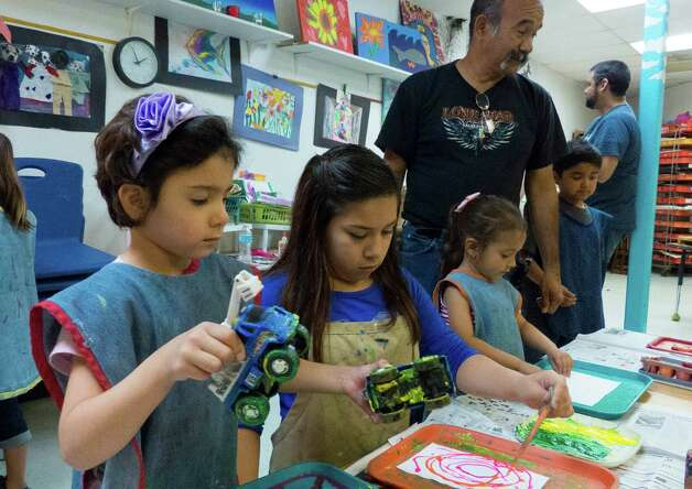 Chloe Rivera, 5, enjoys her birthday party at Artworks Art Studio on Saturday, March, 9, 2013. Photo: Billy Calzada, San Antonio Express-News / San Antonio Express-News
