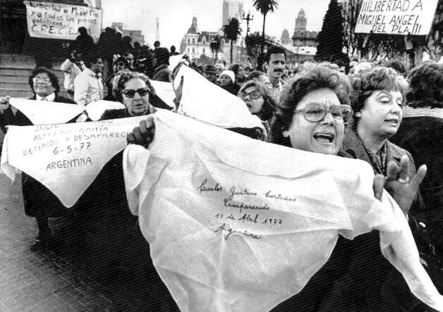 In an oft-repeated scene during the Dirty War years, mothers of disappeared citizens marched in Buenos Aires.  Chronicle file photo/1982