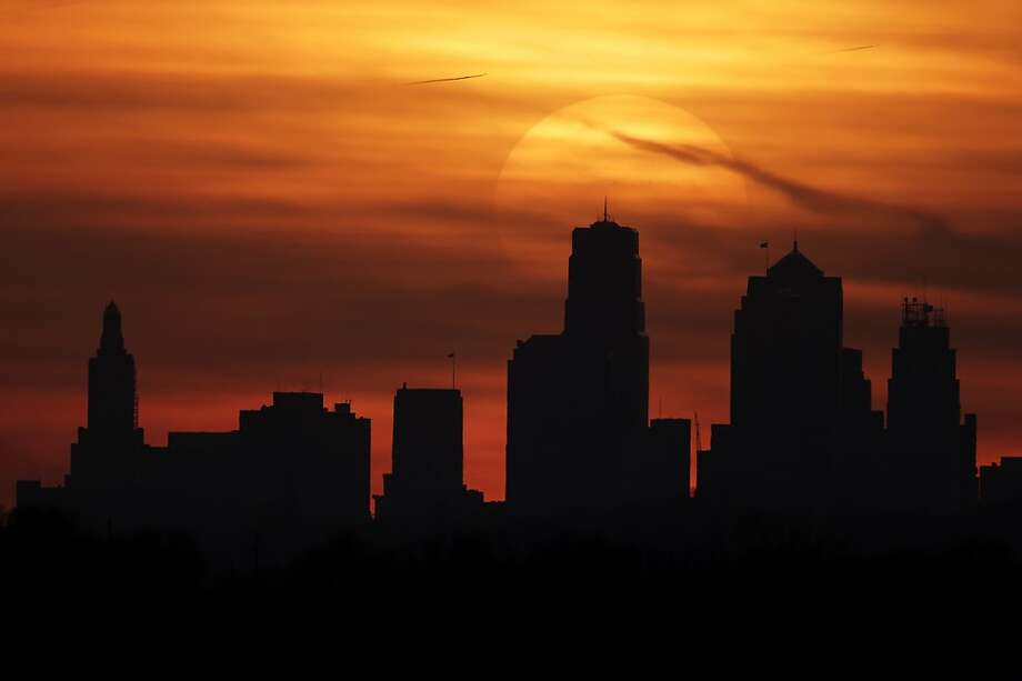 The sun sets behind the skylinein Kansas City, Mo., where photographer Charlie Riedel was scouting for dramatic images. Photo: Charlie Riedel, Associated Press