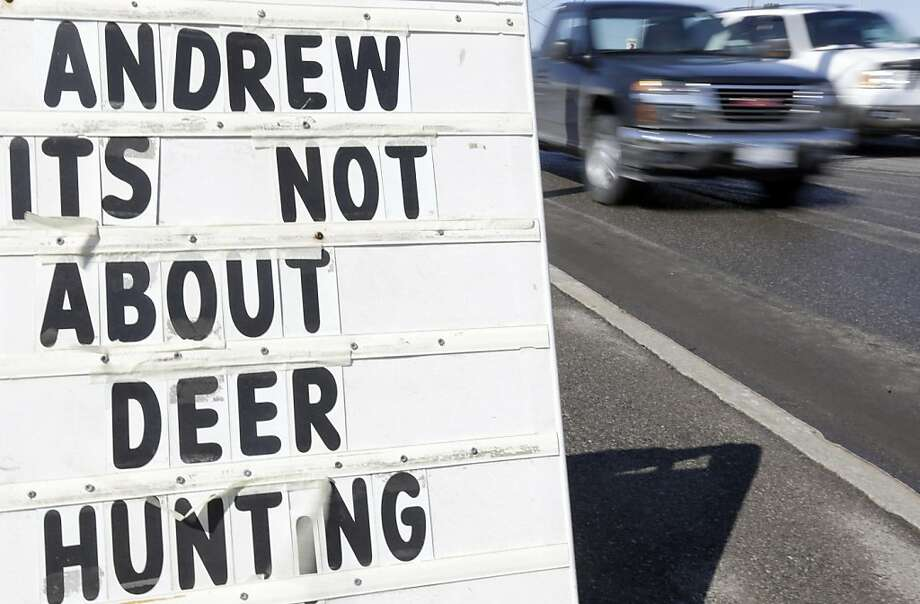"In a New York minute: A sign outside a sporting goods store in Batavia, N.Y., refers to a statement by Gov. Andrew Cuomo - ""No one needs 10 bullets to kill a deer."" The governor pushed through the N.Y. SAFE Act gun control law as an emergency bill with no hearings, no testimony and no time for opponents to make a case to their legislators. Photo: David Duprey, Associated Press"
