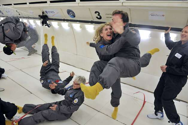 The zero effect: Civilian passengers of the Airbus A330 Zero-G enjoy the feeling of weightlessness during the first zero-gravity flight for paying passengers in Europe. The thrill did not come cheap - each spent about $7,800 for the flight. Photo: Mehdi Fedouach, AFP/Getty Images