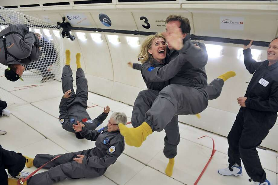 The zero effect:Civilian passengers of the Airbus A330 Zero-G enjoy the feeling of weightlessness during the first zero-gravity flight for paying passengers in Europe. The thrill did not come cheap - each spent about $7,800 for the flight. Photo: Mehdi Fedouach, AFP/Getty Images