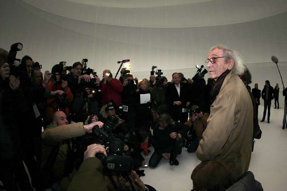 Bulgarian-born artist Christo, known for his large-scale environmental art, leads journalists through his Big Air Package. Photo: Hannelore Foerster, Getty Images / 2013 Getty Images
