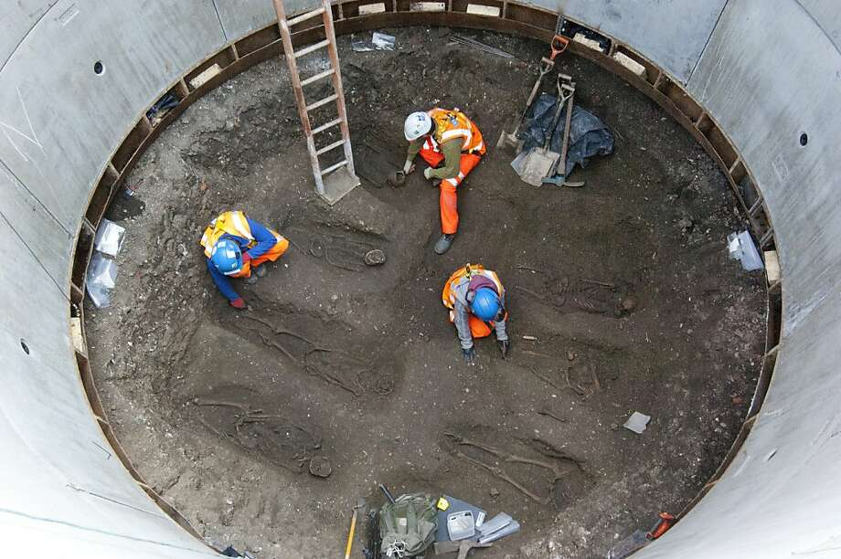 Plague grave:Archaeologists work to uncover skeletons from what is believed to be a mass grave for victims of the Black Death in London. Bones were discovered during excavations to create a Crossrail tunnel shaft under Charterhouse Square. So far 13 skeletons have been exhumed. Photo: Crossrail, AFP/Getty Images