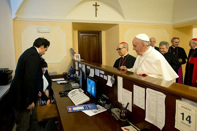 Don't forget to check the honor bar: Pope Francis pays his bill at the reception desk of the Domus Internationalis Paulus VI residence, where he stayed during the conclave in Rome. Photo: -, AFP/Getty Images