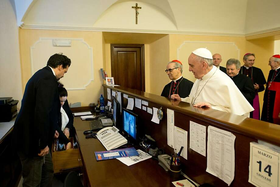 This handout picture released by the Press office shows Pope Francis at the reception desk of the Domus Internationalis Paulus VI residence as he pays the bill of his stay before the conclave on March 14, 2013 in Rome. The first non-European pontiff in more than 1,200 years, Pope Francis is already making his mark with a homespun style that contrasts sharply with that of his more austere predecessor Benedict XVI. AFP PHOTO/OSSERVATORE ROMANO-/AFP/Getty Images Photo: -, AFP/Getty Images