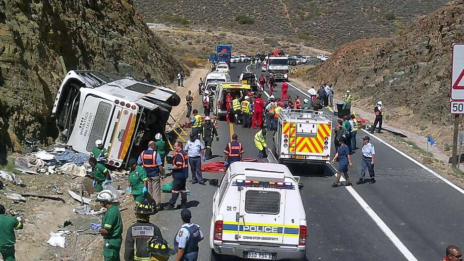 Double-decker tragedy:The wreckage of a double-decker bus carrying a church group lies on the side of a highway after crashing in the mountainous Hex River pass near Cape Town. Rescue teams used a crane to lift the bus and cut away bodywork to extract trapped victims. Twenty-four people were killed and 45 injured. Photo: -, AFP/Getty Images