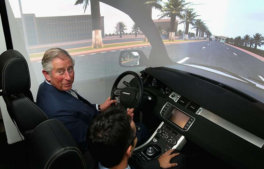 But the wheel's on the wrong side!Prince Charles tries an automobile simulator at the Qatar Science and Technology Park in Doha on the fourth day of a tour of the Middle East. Photo: Chris Jackson, Getty Images