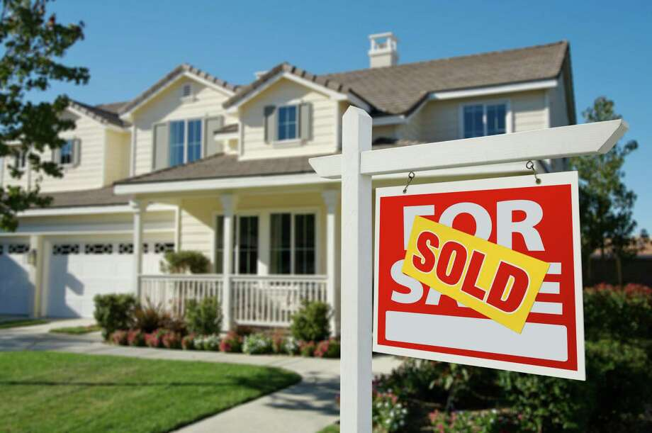 The good news for those transferring out is that houses in Houston are not staying on the market very long. Photo: Andy Dean / iStockphoto