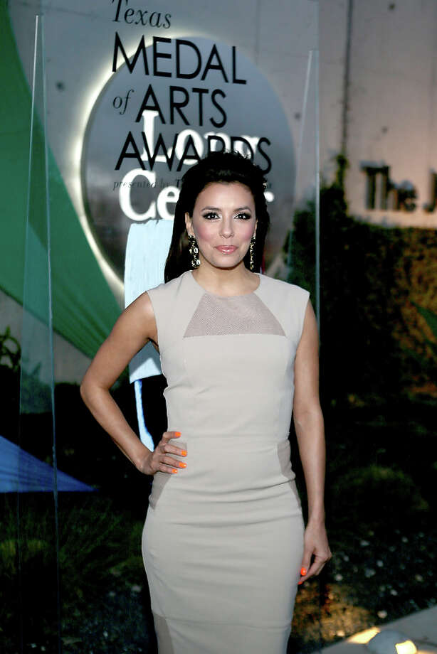 AUSTIN, TX - MARCH 05:  Eva Longoria walks the red carpet before the Texas Medal of Arts Awards show at The Long Center on March 5, 2013 in Austin, Texas. Photo: Gary Miller, FilmMagic / 2013 Gary Miller
