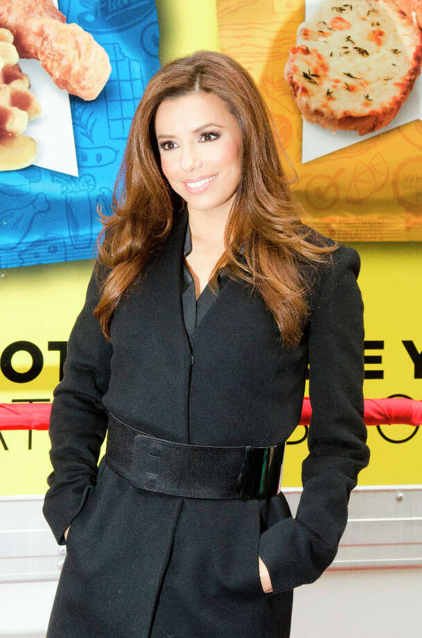 NEW YORK, NY - FEBRUARY 12: Eva Longoria poses for photographers during NYSE Celebrates Lay's Do Us a Flavor Contest Finalists during the opening bell at New York Stock Exchange on February 12, 2013 in New York City. Photo: Kris Connor, Getty Images / 2013 Getty Images