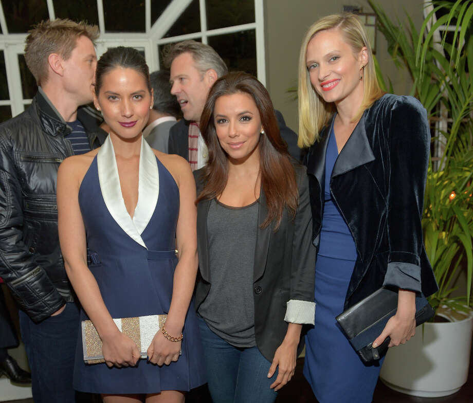 """LOS ANGELES, CA - FEBRUARY 18:  Actors Olivia Munn wearing Juicy Couture, Eva Longoria and Vinessa Shaw attend Vanity Fair and Juicy Couture's Celebration of the 2013 """"Vanities"""" Calendar hosted by Vanity Fair West Coast Editor Krista Smith and actress Olivia Munn in support of the Regional Food Bank of Oklahoma, a member of Feeding America, at the Chateau Marmont on February 18, 2013 in Los Angeles, California. Photo: Charley Gallay / 2013 Getty Images"""