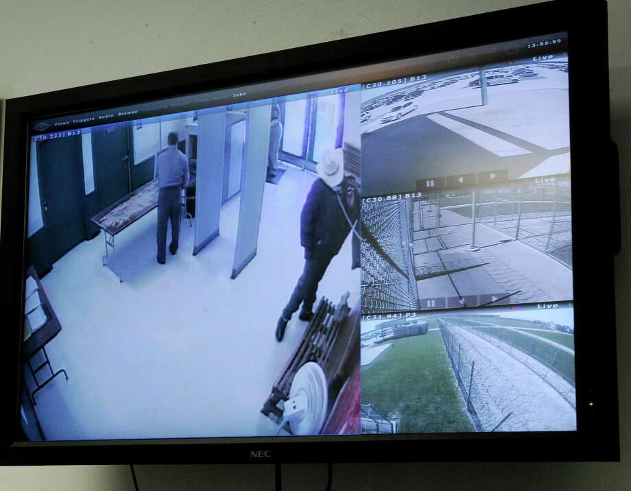A screen in the warden's office at the Stiles Unit of the Texas Department of Criminal Justice displays view from different security cameras at the prison Wednesday, March 13, 2013, in Beaumont, Texas. New technology is being installed at the prison unit to divert calls, texts, emails and internet log-in attempts from contraband phones. (AP Photo/Pat Sullivan) Photo: AP, STF / AP