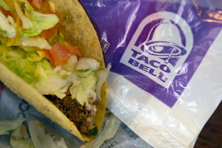 A crispy beef taco from Taco Bell Corp. is arranged for a photograph in San Francisco, California, U.S., on Wednesday, March 13, 2013. Taco Bell sales began to pick up last year after its Doritos Locos Tacos mashup generated buzz even among food critics. Photographer: David Paul Morris/Bloomberg Photo: David Paul Morris, Bloomberg