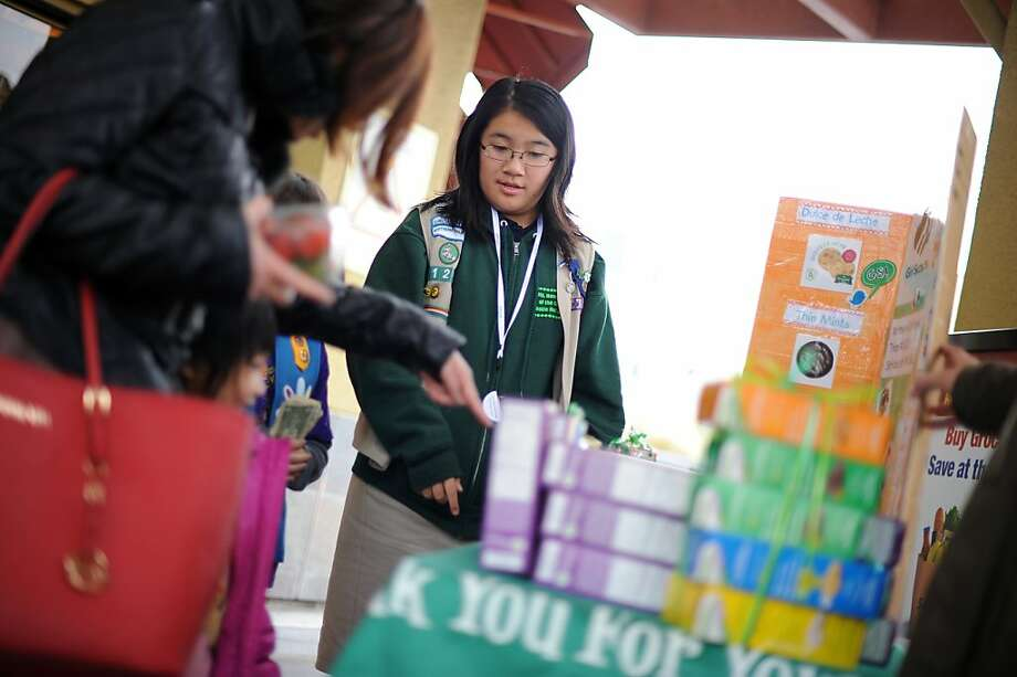 Girl Scout Christiana Wong sells cookies in front of a Safeway in the Richmond District. Christiana. who also sold cookies downtown, says people often buy more when they can use credit or debit cards. Photo: Michael Short, Special To The Chronicle