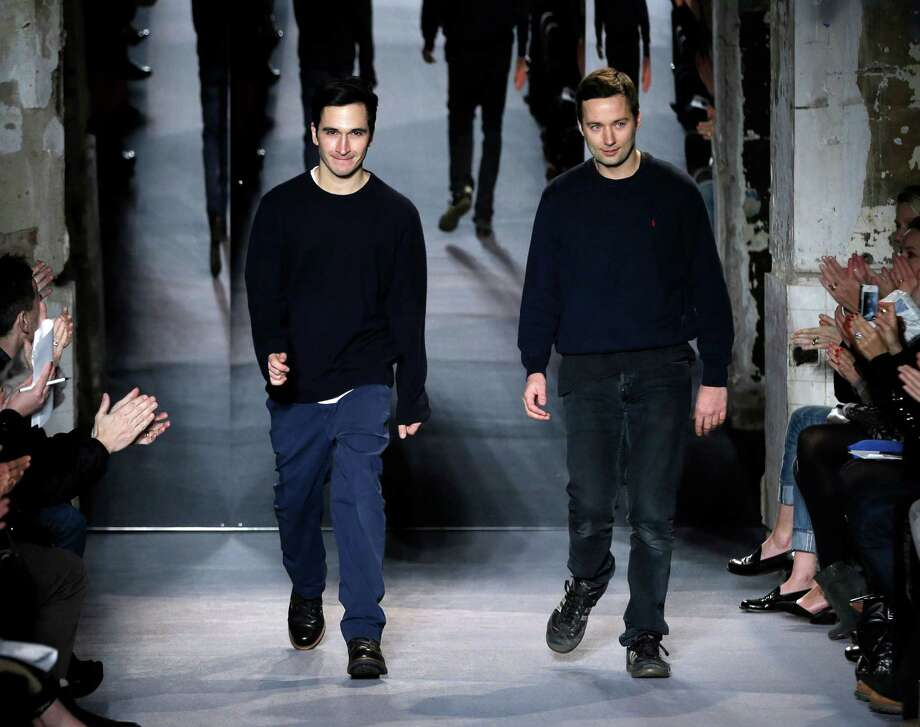 FILE - This Feb. 13, 2013 file photo shows designers Jack McCollough, right, and Lazaro Hernandez after the Proenza Schouler Fall 2013 collection is shown during Fashion Week in New York. Alexander Wang and Proenza Schouler are among the leading nominees for this year?s Council of Fashion Designers of America awards. CFDA president Diane von Furstenberg and CEO Steven Kolb announced Wednesday evening that Proenza?s Lazaro Hernandez and Jack McCollough, and Wang were in the running for both womenswear designer of the year as well as the accessories category.   (AP Photo/Seth Wenig, file) Photo: Seth Wenig, STF / AP