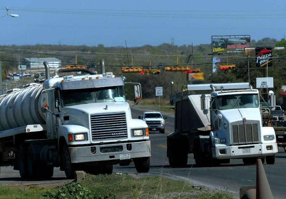 Truck traffic related to the Eagle Ford Shale energy boom travels through Kenedy, Texas, on Friday, March 15, 2013. Photo: Billy Calzada, San Antonio Express-News / San Antonio Express-News