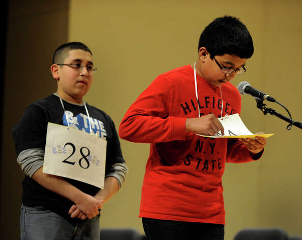 In the final moments of the Hearst Media Services Spelling Bee, Abram Goda, left, of Bridgeport, Conn. and Shrenik Kankaria, of Stamford, Conn. compete Thursday, March 14, 2013. Photo: Carol Kaliff / The News-Times