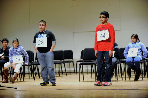 Abram Goda, 12, of Bridgeport, Conn., left and Shrenik Kankaria, of Stamford, Conn. emerge as the two top finalists in the Hearst Media Services Spelling Bee held at Western Connecticut State University in Danbury, Conn. Thursday, March 14, 2013. Photo: Carol Kaliff / The News-Times