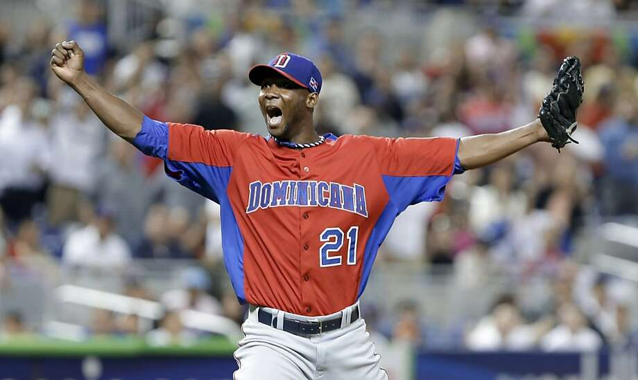 Dominican Republic pitcher Samuel Deduno reacts after striking out United States' Adam Jones to end the first inning of a second-round game of the World Baseball Classic in Miami, Thursday, March 14, 2013. (AP Photo/Wilfredo Lee) Photo: Wilfredo Lee, Associated Press