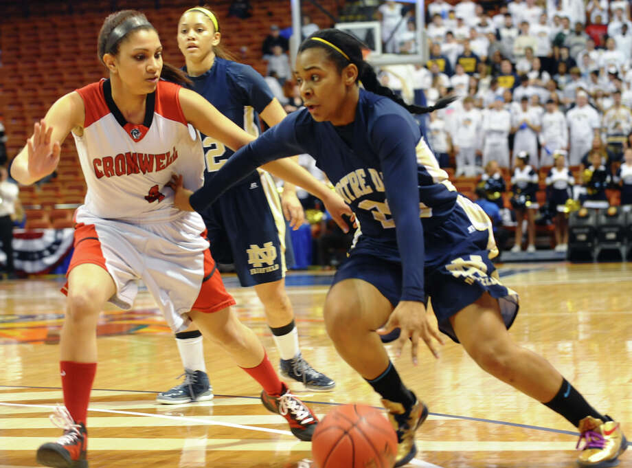 Notre Dame of Fairfield #23 Jovan Kingwood works to get the ball past Cromwell's #4 Alexa Riley, during Class M girls basketball final action at the Mohegan Sun Arena in Uncasville, Conn. on Friday March 15, 2013. Photo: Christian Abraham / Connecticut Post
