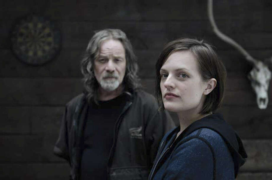 "Peter Mullan (left) plays a father of a missing girl, and Elisabeth Moss is the detective who investigates in the miniseries ""Top of the Lake."" Photo: Parisa Taghizadeh / See-Saw Films"