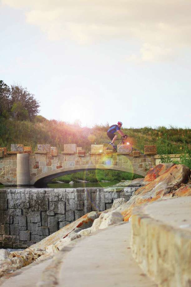 A cyclist enjoys a ride on the new Mission Reach of the River Walk. Photo: COURTESY PHOTO