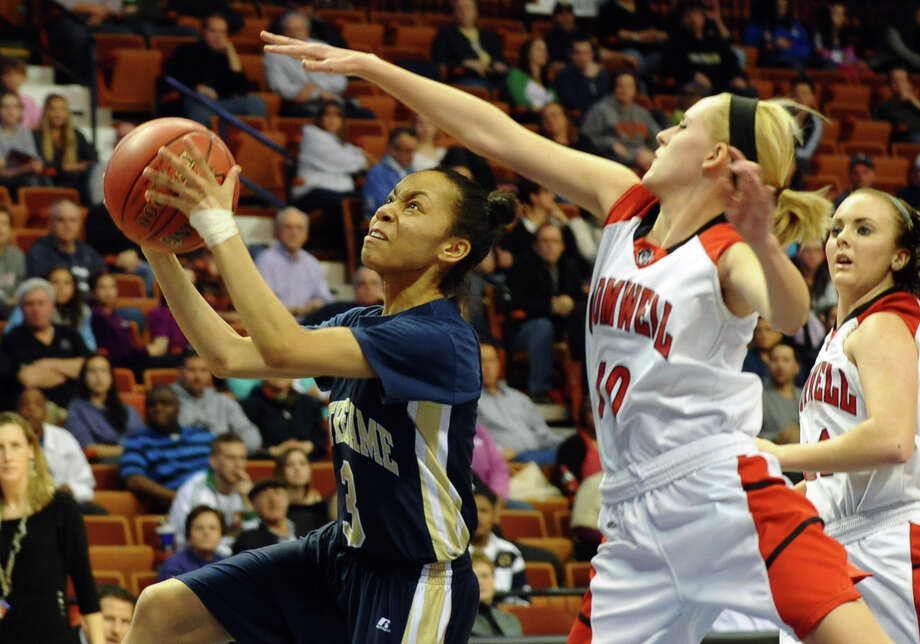 Notre Dame of Fairfield #3 Amber James goes up to the basket as Cromwell's #10 Emily Appleby defends, during Class M girls basketball final action at the Mohegan Sun Arena in Uncasville, Conn. on Friday March 15, 2013. Photo: Christian Abraham / Connecticut Post