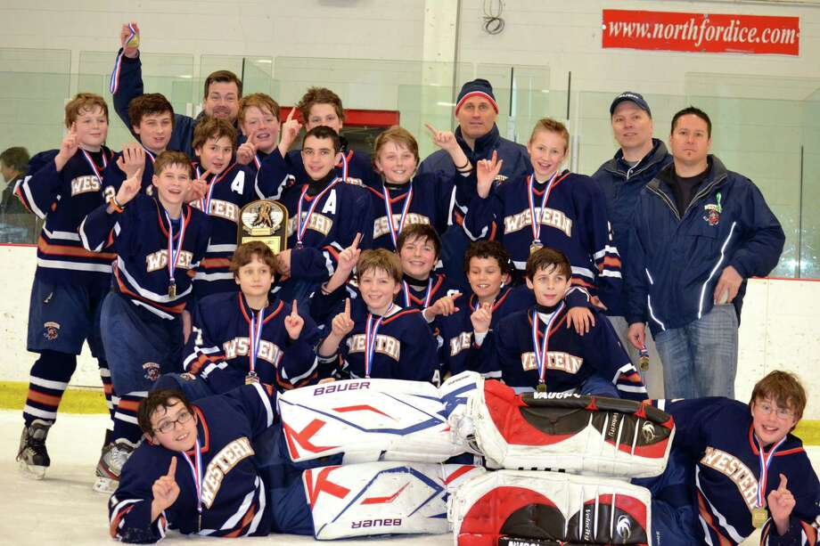 The Western Connecticut Junior Colonials Pee Wee A hockey team, which plays at the Danbury Arena, won the Connecticut Hockey Conference Pee Wee Tier III state championship on Monday night with a 2-1 victory over the Greenwich Blues at the Northford Ice Pavilion. This is the first state championship for the Western Connecticut Youth Hockey Association. The team of 11- and 12-year-olds from the Danbury area is coached by Rich Dibble, John Whitehead and Dave Burke, all of Danbury, and Tim Hanley of Newtown. Members of the team are: Ethan Cox (Newtown), Matthew Burke (Danbury), Jack Hanley (Newtown), Tanner Trew (Bethel), Michael Morlock (Brookfield), Aaron Dibble (Danbury), Matthew Carlucci (Sherman), Devin Marsh (Newtown), Benjamin Paquin (New Milford), Jameson Brown (New Fairfield), Tyler Caldara (Bethel), Andrew Gardner (Newtown), Nathan Torre-Tasso (Newtown), Alexander Fernandes (Danbury), Shjon Whitehead (Danbury), Bryan Almeida (New Milford) and Stephen Fanning (Danbury). Photo: Contributed Photo / The News-Times Contributed