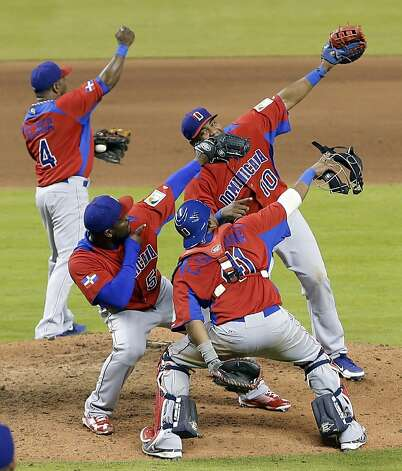 Dominican Republic players celebrate the win over the U.S. that pointed them toward San Francisco. Photo: Alan Diaz, Associated Press