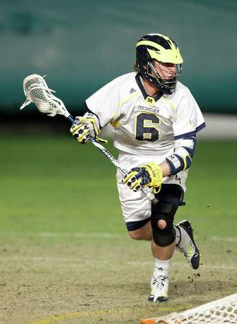 MIAMI GARDENS, FL - MARCH 2: Peter Kraus #6 of the Michigan Wolverines works the ball behind the net against the Army Black Knights during the 2013 Orange Bowl Lacrosse Classic on March 2, 2013 at SunLife Stadium in Miami Gardens, Florida. Army defeated Michigan 12-1. (Photo by Joel Auerbach/Getty Images) Photo: Joel Auerbach, Getty Images / 2013 Joel Auerbach