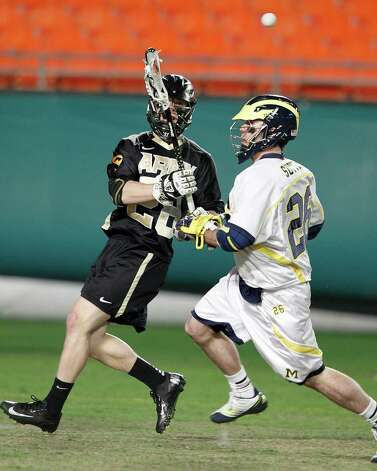 MIAMI GARDENS, FL - MARCH 2: Alex Van Krevel #28 of the Army Black Knights passes the ball while being defended by Sean Sutton #26 of the Michigan Wolverines during the 2013 Orange Bowl Lacrosse Classic on March 2, 2013 at SunLife Stadium in Miami Gardens, Florida. (Photo by Joel Auerbach/Getty Images) Photo: Joel Auerbach, Getty Images / 2013 Joel Auerbach