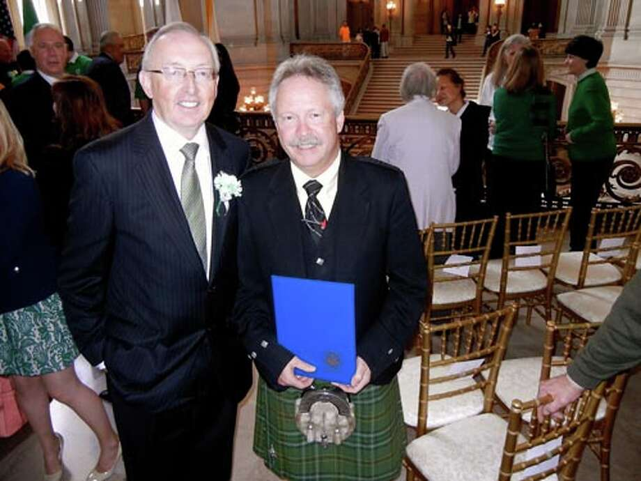 Irish Consul General Gerry Staunton (left) with Brendan O'Leary who received a Mayoral Certificate of Honor on behalf of the Irish Piper Band of San Francisco.