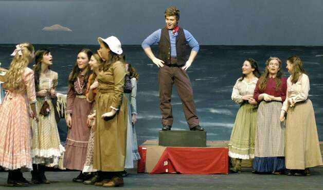 "Bill Bigelow, portrayed by Ben Bayers, is the apple of many girls' eye during in New Milford's High School's all-school musical production of Rodgers & Hammerstein's ""Carousel,"" March 2013 Photo: Norm Cummings"