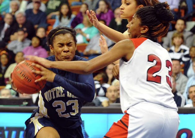 Notre Dame of Fairfield #23 Jovan Kingwood works to get the ball past Cromwell's #23 Janelle Harrison, during Class M girls basketball final action at the Mohegan Sun Arena in Uncasville, Conn. on Friday March 15, 2013. Photo: Christian Abraham / Connecticut Post