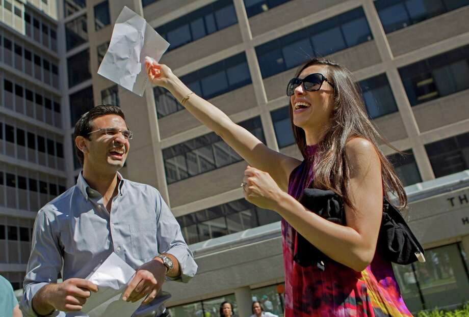 "Holding the pieces of paper that decide their future, Zena Pinnella, 25, who is studying dermatology, and her fiancee Anthony Zoghbi, 25, who is studying psychology, celebrate after both were accepted to do their residencies at Columbia University in New York.189 students at Baylor College of Medicine found out where they would continue their medical training Friday, March 15, 2013, in Houston. ""We were exceedingly nervous,"" Zoghbi said about the possibility of being separated. ""This is amazing, we will be there together."" Photo: Johnny Hanson, Houston Chronicle / © 2013  Houston Chronicle"