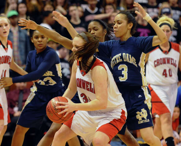 Notre Dame of Fairfield #3 Amber James blocks Cromwell's #34 Kelly Flanigan, during Class M girls basketball final action at the Mohegan Sun Arena in Uncasville, Conn. on Friday March 15, 2013. Photo: Christian Abraham / Connecticut Post