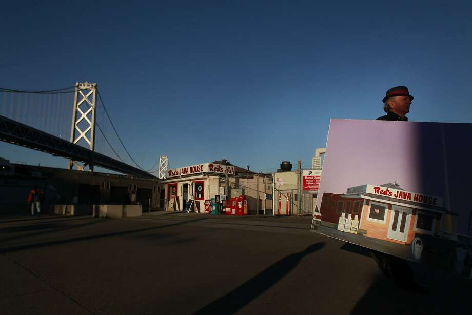 Painter Richard Louis Perri shows off his painting of Red's Java House on the Embarcadero in San Francisco, Calif. Photo: Mike Kepka, The Chronicle