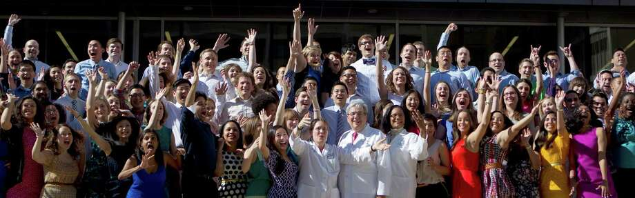 More than 180 Baylor College of Medicine students celebrate their next journey in life with a group picture as 189 students found out where they would continue their medical training Friday, March 15, 2013, in Houston. Photo: Johnny Hanson, Houston Chronicle / © 2013  Houston Chronicle