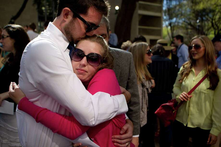 "Kara Beatty, a student studying psychiatry at The University of Texas Medical School at Houston, is held by her husband, Collin Beatty, after she didn't get her first selection of a residency program at Indiana University in Indianapolis during The University of Texas Health Science Center match day. ""It's a bittersweet kind of a feeling,"" Kara said. ""There is a real good chance he will match in Indianapolis. But I have a lot of love support in Virginia. My mentor is there."" Photo: Johnny Hanson, Houston Chronicle / © 2013  Houston Chronicle"