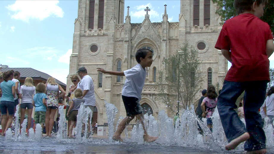 A boy plays in the Main Plaza fountain in front of San Ferando Cathedral in 2008. After being tested, the fountains may begin flowing again. Photo: Billy Calzada / San Antonio Express-News