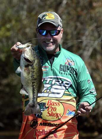 Angler Dennis Tietje is more than excited on a monster bass secured on the second day of the 2013 Bassmasters Elite Series Sabine River Challenge. Photo taken: Randy Edwards/The Enterprise