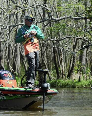 Angler Dennis Tietje hooks a monster on the second day of the 2013 Bassmasters Elite Series Sabine River Challenge. Photo taken: Randy Edwards/The Enterprise