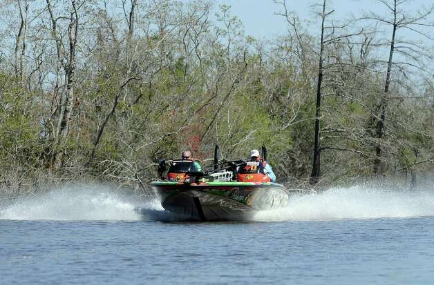 Angler Dennis Tietje flies down a cut headed to a new location off the Sabine River on the second day of the 2013 Bassmasters Elite Series Sabine River Challenge. Photo taken: Randy Edwards/The Enterprise