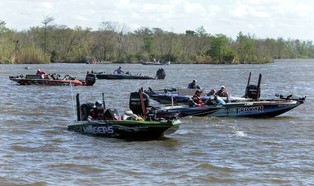 Anglers head back to the boat ramp in a time crunch to make weigh in on the second day of the 2013 Bassmasters Elite Series Sabine River Challenge. Photo taken: Randy Edwards/The Enterprise