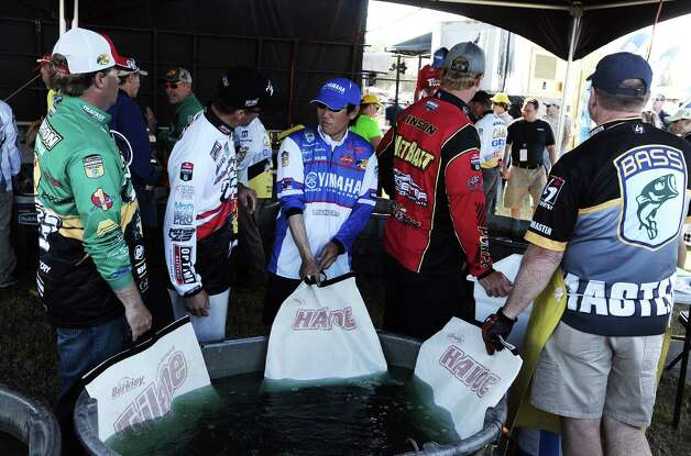 Anglers wait to weigh in on the second day of the 2013 Bassmasters Elite Series Sabine River Challenge. Photo taken: Randy Edwards/The Enterprise