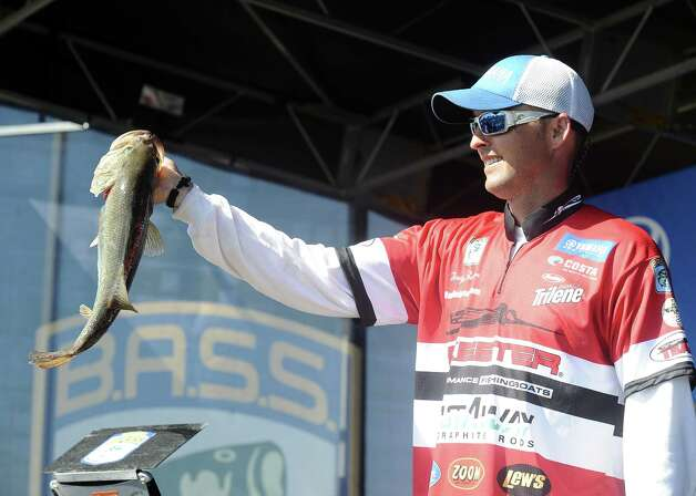 Angler Marty Robinson shows off his big fish at weigh in on the second day of the 2013 Bassmasters Elite Series Sabine River Challenge. Photo taken: Randy Edwards/The Enterprise