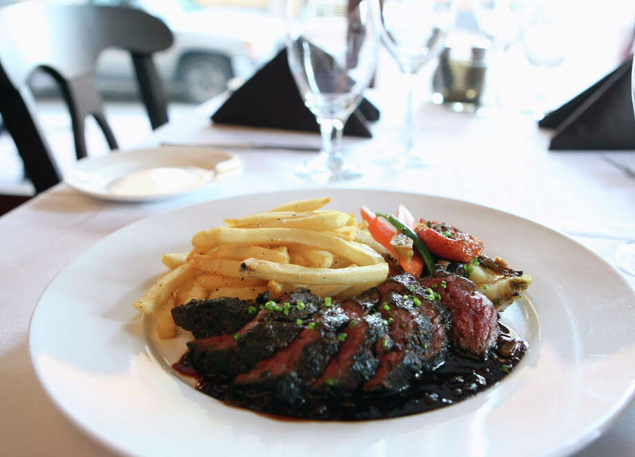 When it comes to food, the French won't turn away a good plate of hangar steak with a side of pomme frites. Photo: HELEN L. MONTOYA, SAN ANTONIO EXPRESS-NEWS / hmontoya@express-news.net