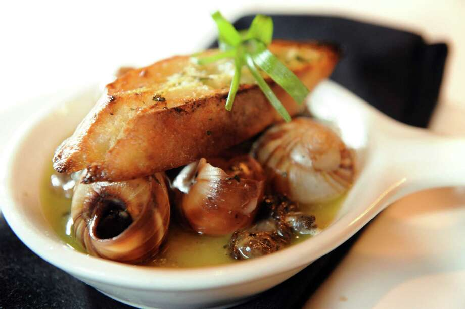 A little butter, wine and garlic will turn that American garden nuisance into the French-loved dish of escargot. Photo: Cindy Schultz, Albany Times Union / ONLINE_YES