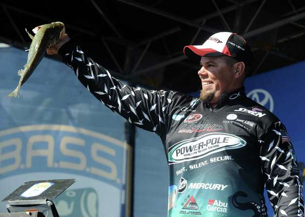 Angler Chris Lane shows off his big fish at weigh in on the second day of the 2013 Bassmasters Elite Series Sabine River Challenge. Photo taken: Randy Edwards/The Enterprise